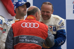 LMP1 podium: David Brabham and Team Peugeot Total boss Olivier Quesnel receives congratulations from Head of Audi Sport Dr. Wolgang Ullrich