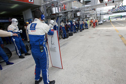 Team Peugeot Total gets ready for a pit stop