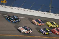 Denny Hamlin, Joe Gibbs Racing Toyota and Tony Stewart, Stewart-Haas Racing Chevrolet lead the field