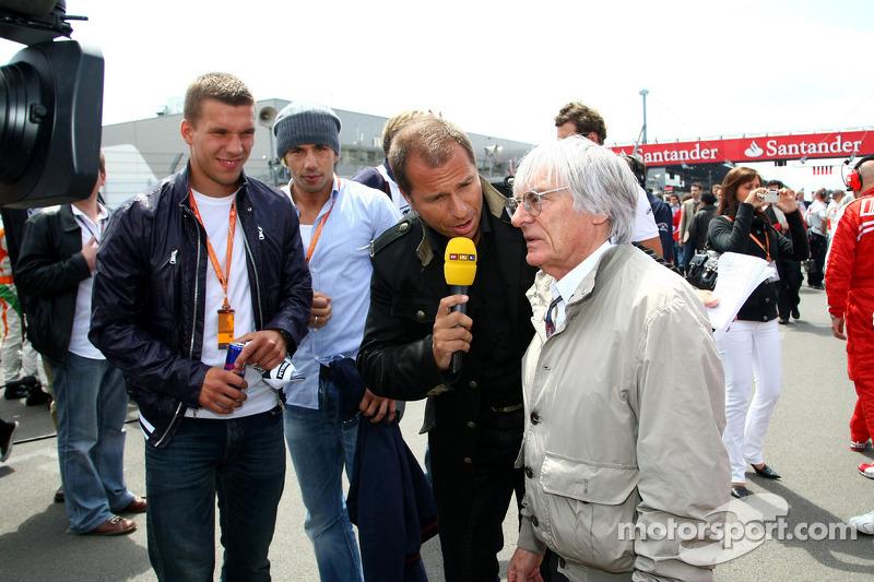 Lukas Podolski, Kai Ebel en Bernie Ecclestone