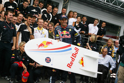 Race winner Mark Webber, Red Bull Racing celebrates with his team