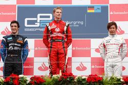 Podium: race winner Nico Hulkenberg, second place Alvaro Parente, third place Kamui Kobayashi