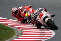 Alex De Angelis, San Carlo Honda Gresini  and Niccolo Canepa, Pramac Racing