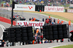 Wet tyres are brought onto The grid after the race was red flagged