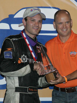 Bobby Santos III receives the trophy for the J.D. Byrider 100 Silver Crown race