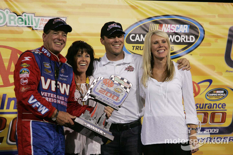 Victory lane: race winner Ron Hornaday celebrates with Kevin and DeLana Harvick