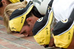 Race winner Jimmie Johnson and his team celebrate with the traditional Brickyard kiss