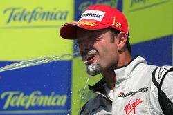 Podium: champagne celebration for race winner Rubens Barrichello