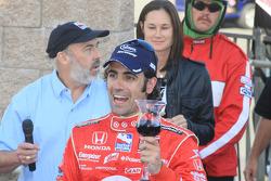 Victory lane: race winner Dario Franchitti, Target Chip Ganassi Racing tastes the victory wine