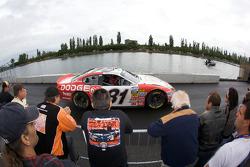 Fans watch as Alex Tagliani heads back to his garage