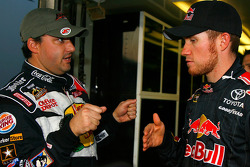 Tony Stewart, driver of the #14 Bass Pro Shops Chevrolet speaks with Brian Vickers, driver of the #83