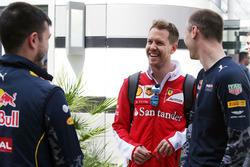 Sebastian Vettel, Ferrari with members of Red Bull Racing