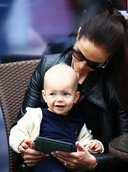 Minttu Virtanen, wife of Kimi Raikkonen Ferrari, with their baby son Robin