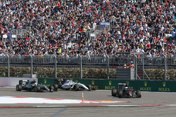 Fernando Alonso, McLaren MP4-31 leads Lewis Hamilton, Mercedes AMG F1 Team W07 and Valtteri Bottas, Williams FW38
