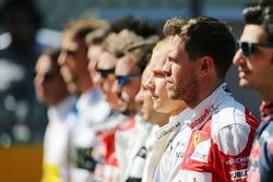 Sebastian Vettel, Ferrari as the grid observes the national anthem