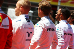 Nico Rosberg, Mercedes AMG F1 and Lewis Hamilton, Mercedes AMG F1 as the grid observes the national anthem