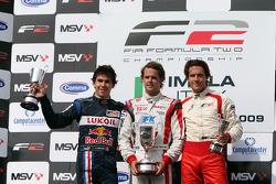 Podium: Second place Robert Wickens, race winner Andy Soucek and third place Milos Pavlovic celebrate on the podium