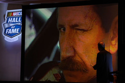 NASCAR Vice President of Corporate Communications Jim Hunter watches a video of Dale Earnhardt after he was selected to the NASCAR Hall of Fame