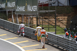 Jarno Trulli, Toyota F1 Team,with Fernando Alonso, Renault F1 Team and Adrian Sutil, Force India F1 Team walking back after crashing on lap one