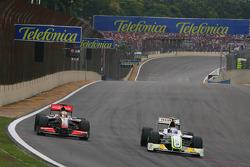 Lewis Hamilton, McLaren Mercedes and Rubens Barrichello, BrawnGP