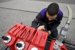 A crew member for the No. 18 Fed Ex Toyota crew at work