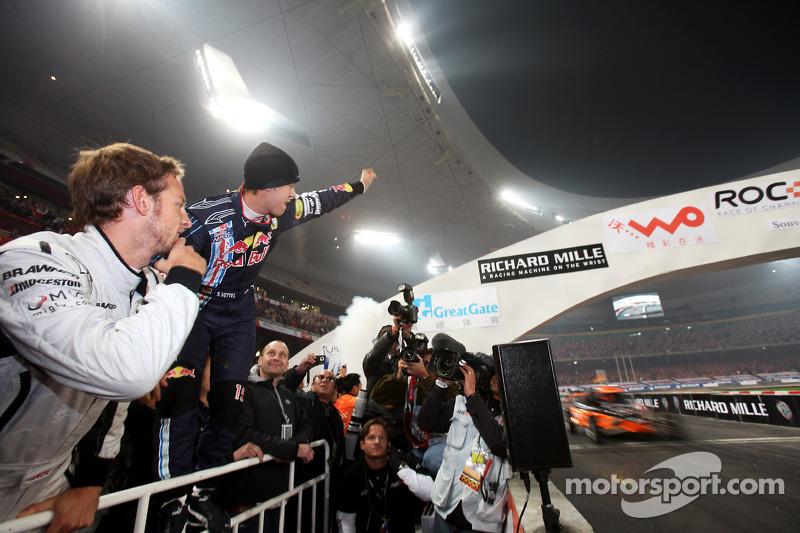 Final, race 3: Sebastian Vettel celebrates as Michael Schumacher wins the final race, while Jenson Button looks on