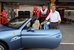 Luca di Montezemolo, Felipe Massa and Fernando Alonso after the drive around the track in a Ferrari California