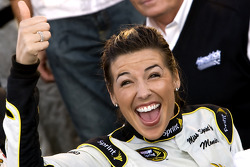Victory lane: Miss Sprint Cup, Monica Palumbo, gives a thumbs up