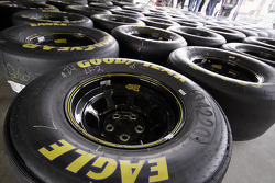 Tires for the 26 Crown Royal Ford Fusion are spread out in the garage area