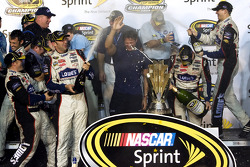 Championship victory lane: 2009 and 4th time NASCAR Sprint Cup Series champion Jimmie Johnson celebrates with his team