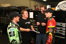 Ricky Carmichael, driver of the No. 4 Turner Motorsports Toyota, and James Buescher, driver of the No. 51 Phoenix Racing Toyota, talk with crew members