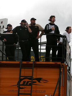 Team members watch track action