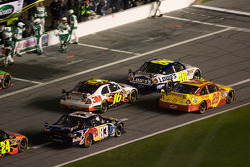 Kevin Harvick, Richard Childress Racing Chevrolet, Jimmie Johnson, Hendrick Motorsports Chevrolet, Greg Biffle, Roush Fenway Racing Ford, Brian Vickers, Red Bull Racing Team Toyota battle on pit road