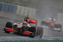 Jenson Button, McLaren Mercedes, MP4-25 leads Fernando Alonso, Scuderia Ferrari, F10