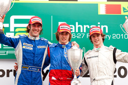Charles Pic celebrates his victory on the podium with Giacomo Ricci and Javier Villa
