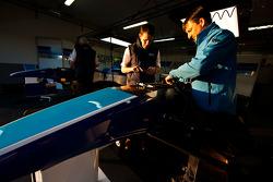 Mechanics work on the car of Alexander Simms