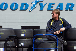 A Good Year worker sits on top of tires