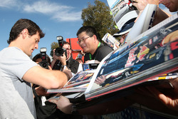 Mark Webber, Red Bull Racing, signs autographs