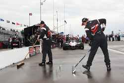 Team Penske team members sweep the pitlane