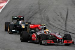 Lewis Hamilton, McLaren Mercedes leads Jarno Trulli, Lotus F1 Team