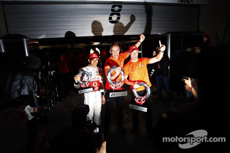 Race winner Jenson Button, McLaren Mercedes, celebrates with Lewis Hamilton, McLaren Mercedes, Marti