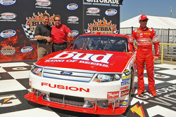Darrell Waltrip and Kasey Kahne unveil the retro Budweiser Ford that Kahne will race at RIR; the car is painted in same format as that used by Waltrip in 1985