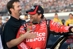 Tony Stewart, Stewart-Haas Racing Chevrolet shares a laugh with J.D. Gibbs