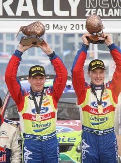 Podium: winners Jari-Matti Latvala and Miikka Anttila celebrate