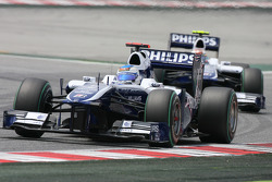 Rubens Barrichello, Williams F1 Team leads Nico Hulkenberg, Williams F1 Team