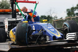 The damaged Sauber C35 of Marcus Ericsson, Sauber F1 Team is recovered back to the pits on the back of a truck during qualifying