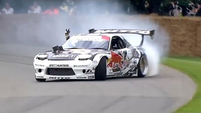 Mad Mike Drifting the Red Bull RX7 up the Goodwood Hill Climb